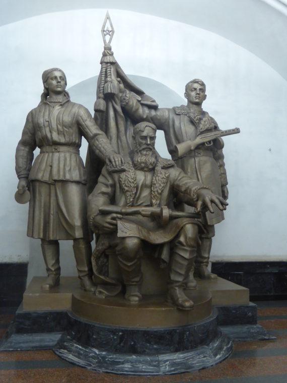 Three men carrying guns, holding the flag...